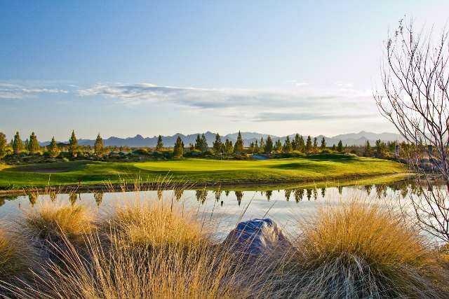 A view over the water of a green at Los Lagos Golf Club.