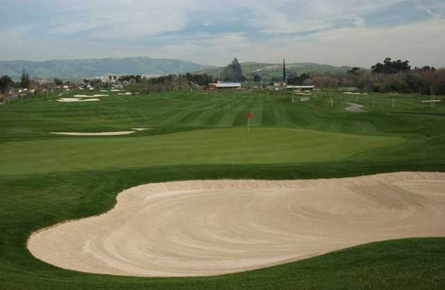 A view of green protected by bunkers at Los Lagos Golf Course