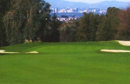 A view of green guarded by bunkers at Eighteen Hole Course from Villages Golf & Country Club