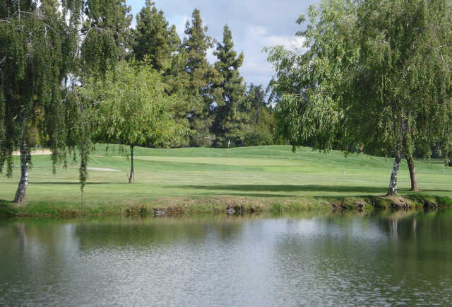 A view over the water of green #15 at San Jose Golf Course