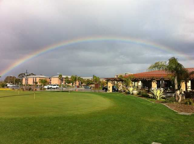 A view of the clubhouse and putting green at Miramar Memorial Golf Course