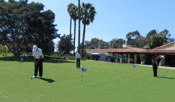 A view of the practice putting green and clubhouse in background at Bernardo Heights Country Club