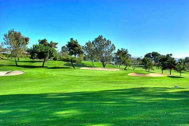 A view of a green guarded by bunkers at the Country Club of Rancho Bernardo.