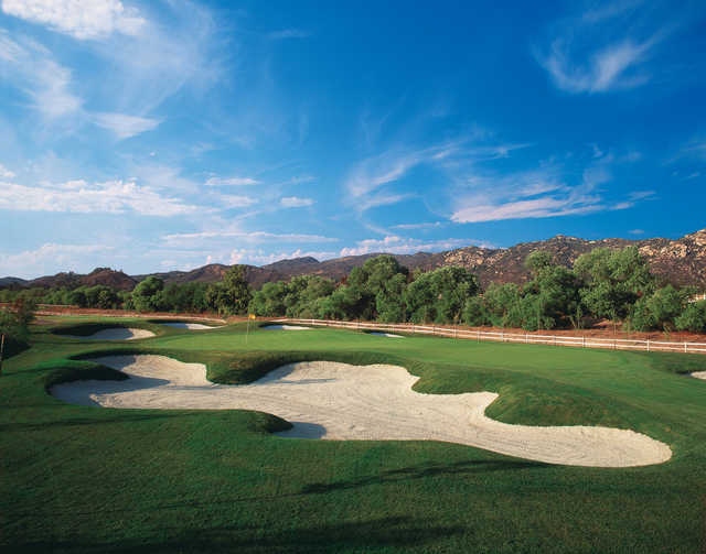 A view of a hole protected by bunkers at Reidy Creek Golf Course