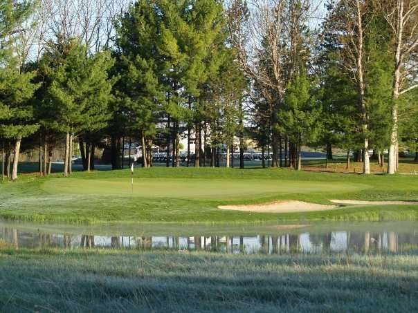 A view over the water of a green at Manistee National Golf & Resort