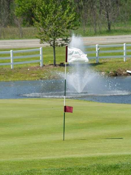 A view of a hole at Manistee National Golf & Resort with water fountain in background
