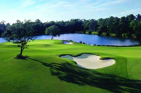 A view of a hole with water in background at Ritz-Carlton Members Golf Club.