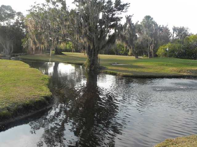 A view over the water of green at Timber Creek Golf Course