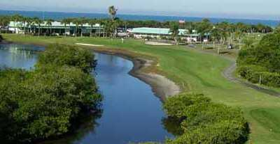 A view of a fairway with water on the left at Lake Venice Golf Club