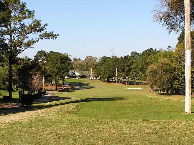 A view of fairway with clubhouse in background at West End Golf Course