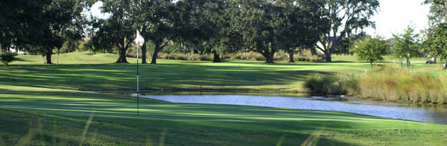 A view of a green surrounded by water at North Shore Golf Course