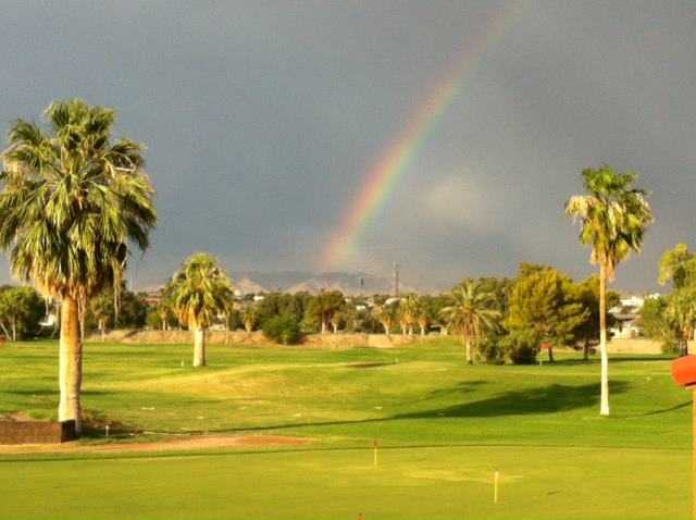 A rainbow view over the practice putting area at Rivers Edge Golf Course