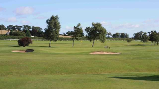 A view of a hole guarded by sand traps at Kelso Golf Club