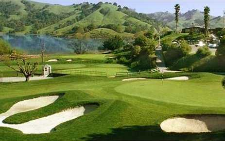 A view of a green guarded by sand traps at Indian Valley Golf Club