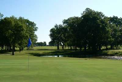 A view of a green with water in background at Gainesville Golf Course