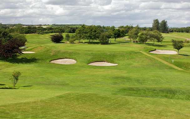 A view of the 8th green protected by bunkers at Bathgate Golf Club
