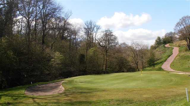 A view of green guarded by bunker at Carluke Golf Club