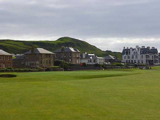 A view of the clubhouse with Championship Course 18th green in foreground at Machrihanish Golf Club