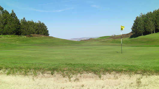 A view of hole #3 guarded by sand trap at Port Glasgow Golf Club