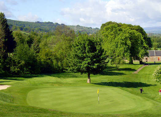 A view of green with bunker on the left side at Cochrane Castle Golf Club