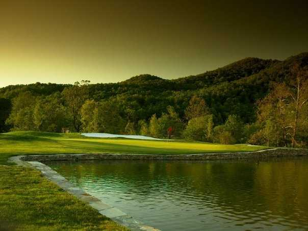 A view over the water of a green at RedTail Mountain Golf Club
