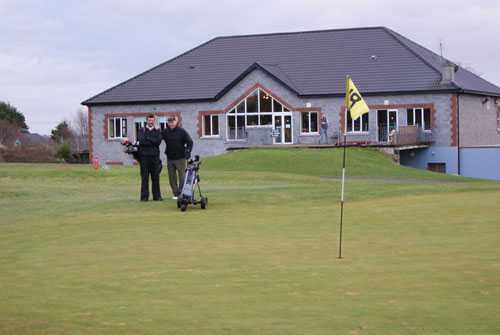 A view of the clubhouse with green #18 in foreground at Kilrush Golf Club