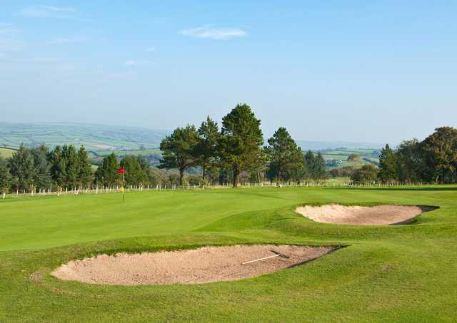 A view of green protected by bunkers at Carmarthen Golf Club
