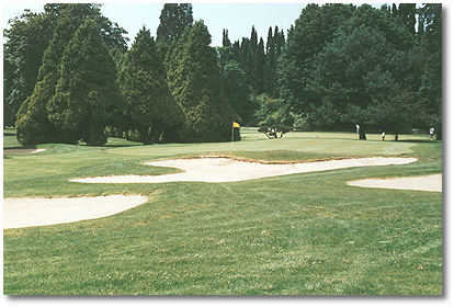 Eastmoreland #9: Hole #9 is the second longest par 5 on the course. Trees and shrubs line the fairway from the tee to a green that is well protected by one bunker to the left-front and three to the right-front