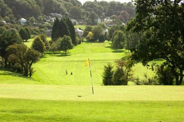 A sunny view of green at St. Melyd Golf Club
