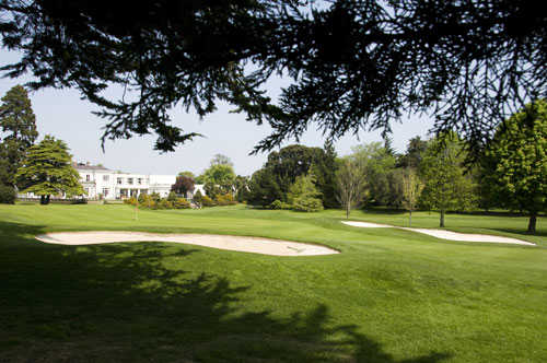 A view of green protected by bunkers at Elm Park Golf and Sports Club