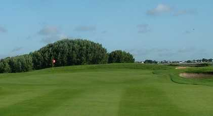 A view of a green protected by bunkers at St. Anne's Golf Club