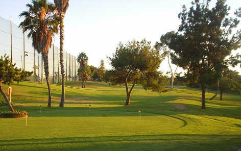 A view of the putting green and 1st tee at Newport Beach Golf Course