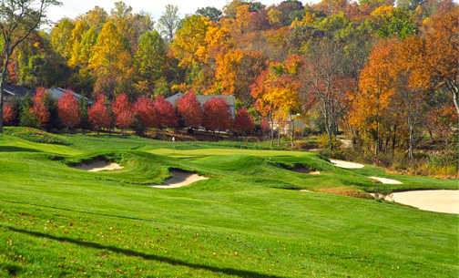A view of a green protected by bunkers from The Golf Course At Glen Mills
