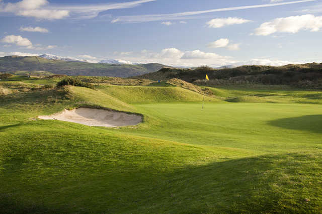 A view of green with sand trap on the left side at Porthmadog Golf Club