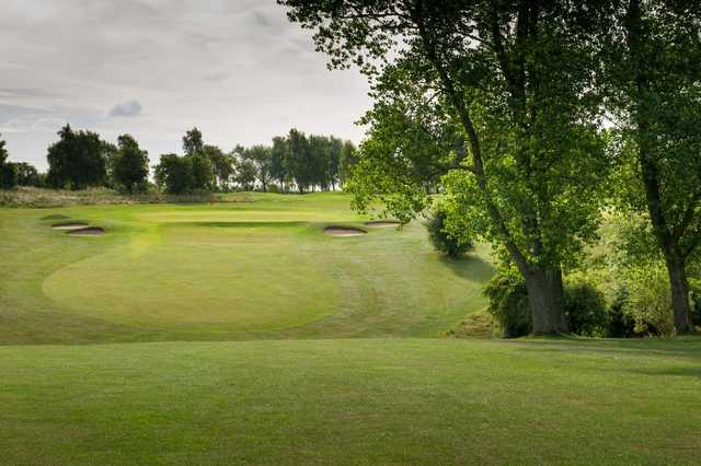 View of an approach shot to a well-protected green at Bedford & County Golf Club