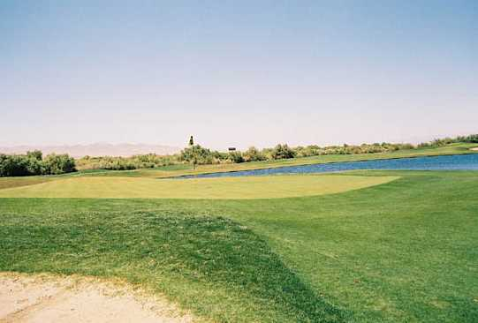 A view of green #8 with water coming into play at Mojave Resort Golf Club