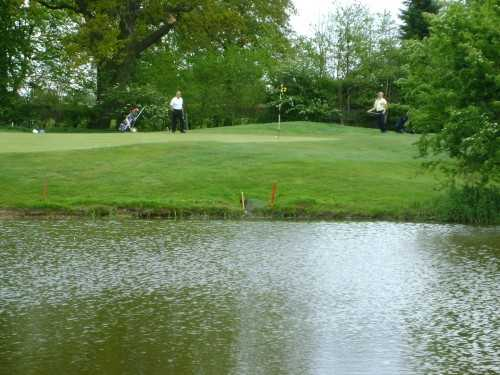 A view over the water of green at Billingbear Park Golf Club