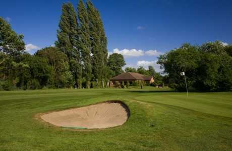 A view of  a hole guarded by bunker at Datchet Golf Club
