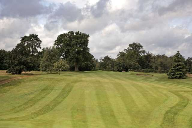 A view of the 13th green and fairway at Newbury & Crookham Golf Club
