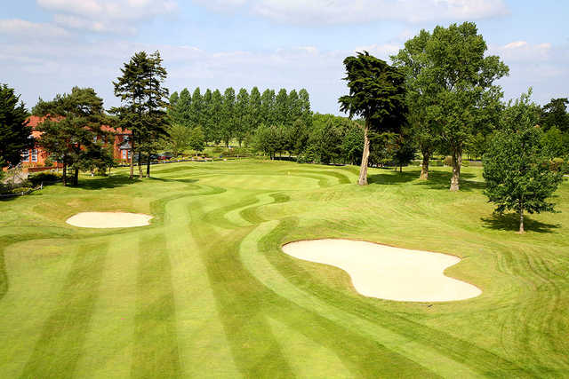 A view of the 18th green at Sand Martins Golf Club