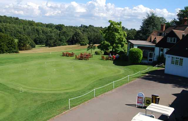 A view of the clubhouse and putting green at Temple Golf Club