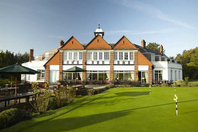 A view of the clubhouse and putting green at Burnham Beeches Golf Club