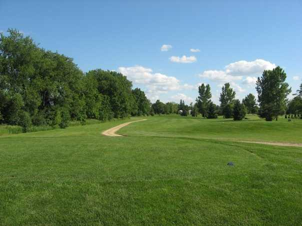 A view from a tee with a narrow path in background at Blue from Coachman's Golf Resort.
