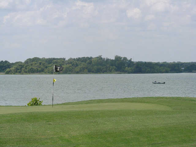 A view of the 3rd green with water in background at Cleburne Golf Links.