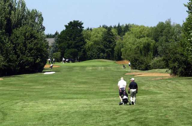 Golfers on the fairway at The Cambridgeshire Golf Club