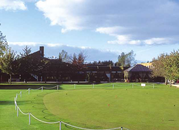 A view of the clubhouse and putting green at The Cambridgeshire Golf Club