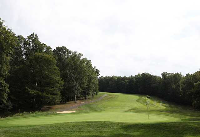 A view of hole #1 with cart path on the left side at Pohick Bay Golf Course