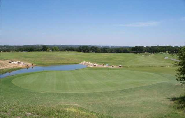 A view of green with water coming into play at The Club at Rebecca Creek