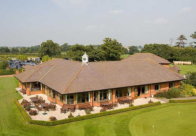 A view of the clubhouse and putting green at Eaton Golf Club