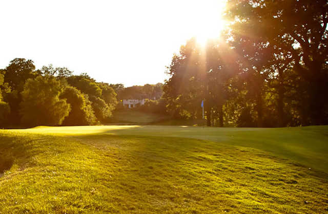 A sunny view of a green at Mere Golf Resort & Spa
